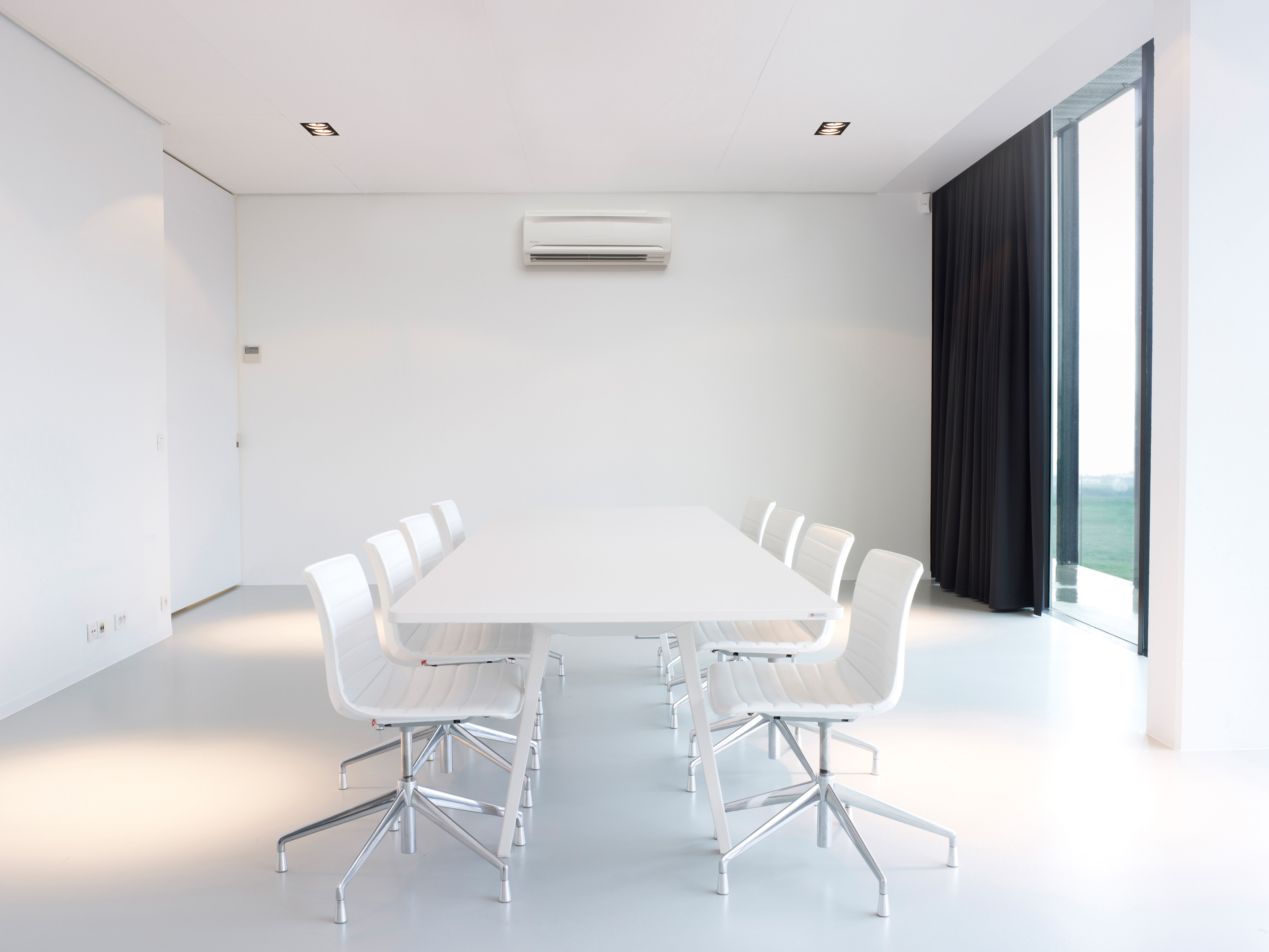 modern meeting room with wall-mounted AC indoor unit